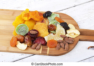 Organic Healthy Assorted Dried Fruit on wine board. Selective focus.