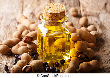 Organic healthy tamarind oil for beauty and health close-up....