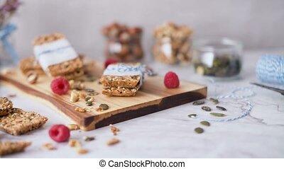 Organic homemade granola bars on rustic marble stone kitchen...