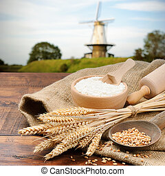 Organic ingredients for bread preparation on old wooden...