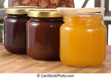 organic jams - Small jar with organic homemade jams on wood...