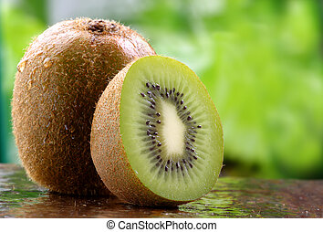 Organic Kiwi fruit - Organic kiwi fruit on a stone counter.