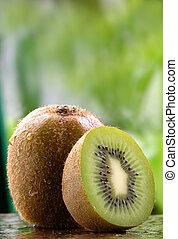 Organic Kiwi fruit - Organic kiwi fruit on a stone counter.