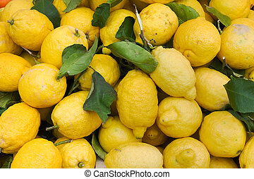 heap of yellow lemons at italian market - lemon peel imperfect because grown without treatment