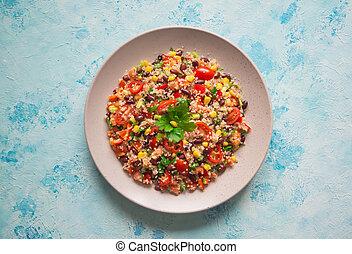 Organic Mexican black bean corn quinoa salad. Top view.
