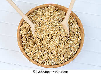 Organic oat flakes in bamboo bowl