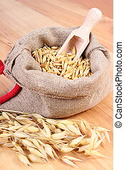 Organic oat grains in jute bag, healthy nutrition concept