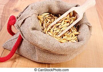 Organic oat grains in jute bag, healthy nutrition
