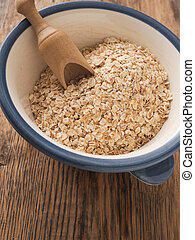 Organic oat meal in a bowl - Organic oat meal in a ceramic ...