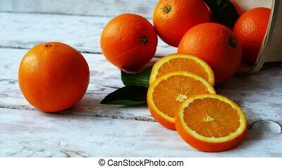 Organic Orange freshly picked in a basket on stylish table,