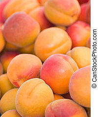 Vertical Photo of Nectarines and Peaches Abstract background with shallow depth of field