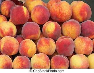 Big pale of fresh organic peaches fruit