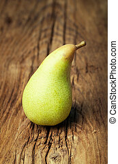 Organic pear on wooden vintage surface
