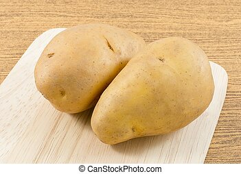Organic Potatoes Tuber on A Cutting Board