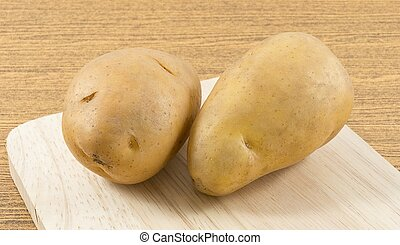 Organic Potatoes Tuber on A Wooden Board