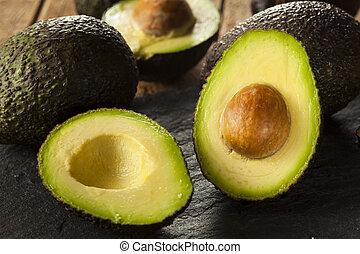 Organic Raw Green Avocados Sliced in Half