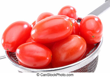 Organic red grape tomatoes - Close up of a group organic...