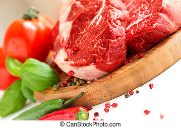 Organic Red Raw Steak on cutting board