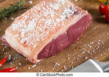 Organic Red Raw Steak Sirloin on wooden board