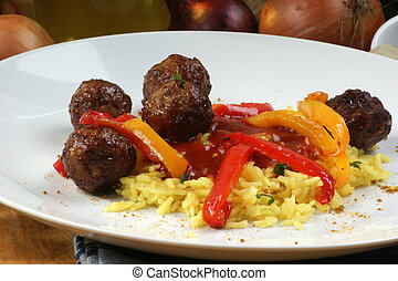 organic rice with grilled meatballs on a plate