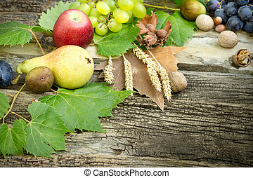 Organic seasonal autumn fruit on rustic wooden table (healthy diet , healthy eating)