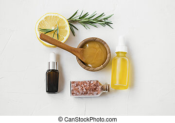Organic skincare ingredients with manuka honey, oils, bath salts, rosemary and lemon for skincare masks and treatments, natural cosmetic ingredients, top view