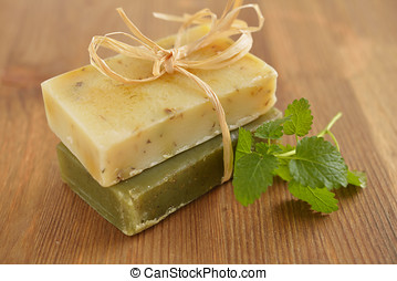 Organic soap and mint on a rustic table
