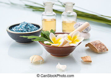Spa concept with Mortar and Pestle, Flowers, leaf, essential oil, and salt
