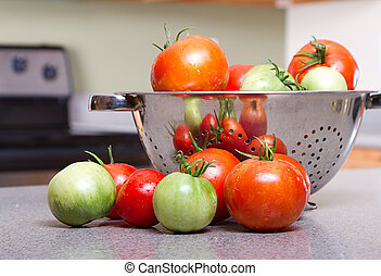 organic tomatoes in a colander