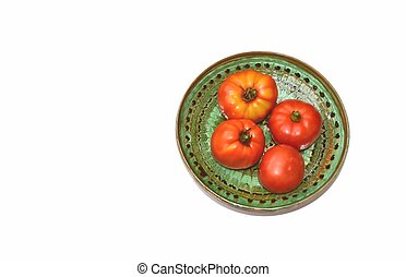 Organic Tomatoes On a Green Plate