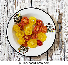 colorful tomato in galvanized bowl in rural atmosphere. -...