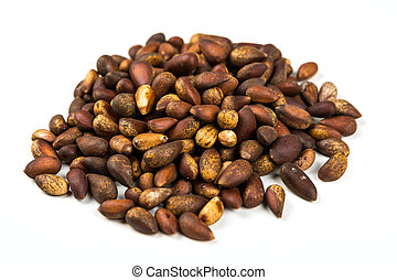 Organic unhulled pine nuts isolated on a white background