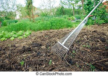 Organic vegetable garden. Fertilization with compost.