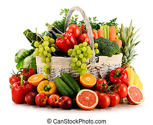 Organic vegetables and fruits in wicker basket isolated on white