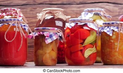 Organic vegetables in glass jars. - Organic vegetables and...