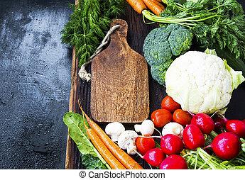 Organic vegetables harvest frame. Wooden board with fresh bio vegetables