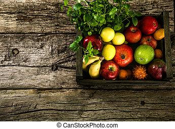 Organic vegetables on wood - Organic fruit on wood. Rustic ...