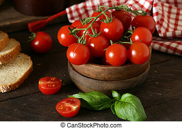 organic vegetables, tomatoes in a wooden bowl