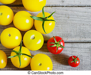 Organic yellow cherry tomatoes a wooden table - Organic...