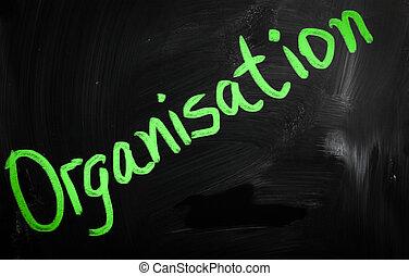 """""""Organisation"""" handwritten with white chalk on a blackboard"""