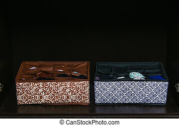 Organization of storage of socks and panties in the drawer of the chest of drawers, cabinet.