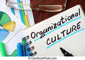 Organizational Culture written in a notepad. Business...