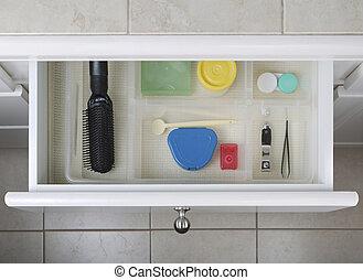 Organized Bathroom Drawer - Open bathroom drawer with...