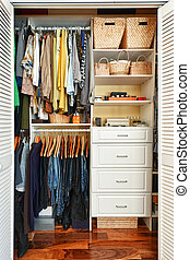 Organized closet - Clothes hung neatly in organized closet...