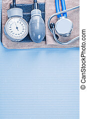 organized copyspace stethoscope with blood pressure monitor on b