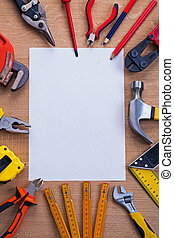 organized copyspace white blank sheet of paper and tools on ...