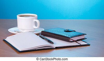 Organizer and cup of coffee - Open notepad the handle an ...