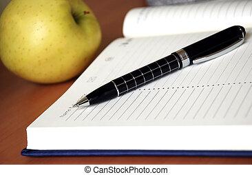 Organizer - organizer with metallic black pen on desk