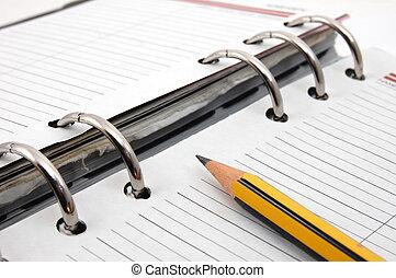organizer - business organizer on white background with pen