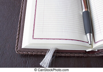 Organizer   - Organizer and pen on the table